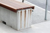 Leaked timber tannin stains on a concrete bench