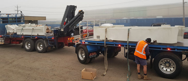SVC concrete products loaded on a delivery truck.