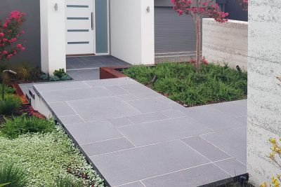 Charcoal concrete paving in an ashlar paving pattern at the entrance to a private residence | SVC Products