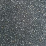 Charcoal concrete swatch featuring light coloured pebbles
