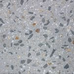 Mid-grey concrete swatch featuring large chunks of stone aggregates