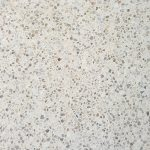 Cream-coloured concrete swatch featuring small coloured pebbles
